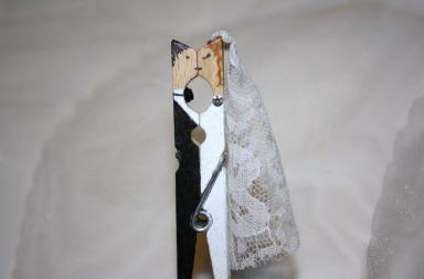 Molletta bacio degli sposi come segnaposto per il matrimonio